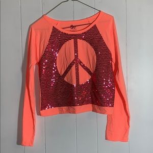 Coral long sleeve with a pink sequin peace sign
